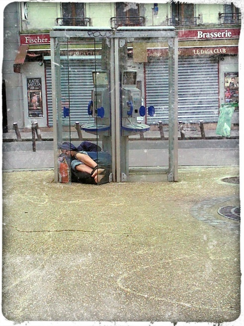 Homeless Man in Phone Booth (Paris)
